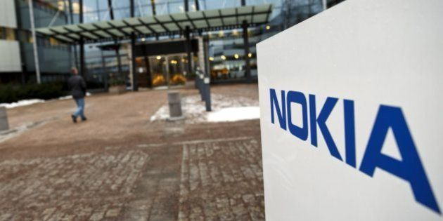 FILE - This Thursday, Jan. 29, 2015 shows the Nokia head offices in Espoo, Finland. Nokia says it is...
