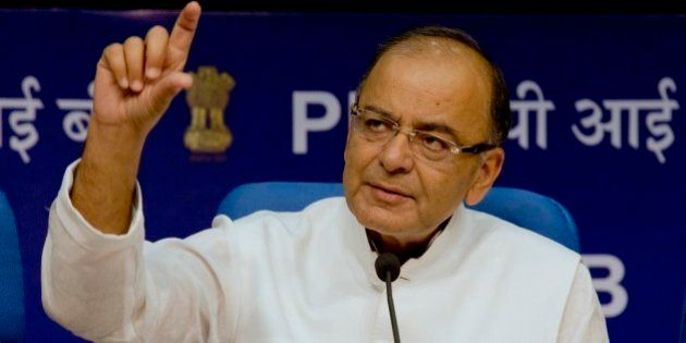 Indian Finance Minister Arun Jaitley addresses a press conference after the 14th Finance Commission report...