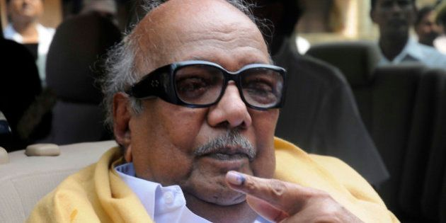Tamil Nadu state Chief Minister M. Karunanidhi displays the indelible ink mark on his finger after casting...