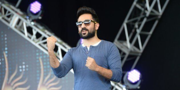 Bollywood actor Vir Das arrives for a rehearsal on stage at the Mid Florida Credit Union Amphitheater...