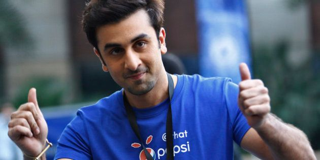 Indian Bollywood actor Ranbir Kapoor displays thumbs-up sign during a promotional event of soft drink...