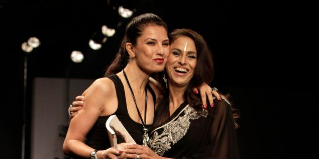 Indian designer Ritu Beri, left, hugs writer Shobha De after Beri's show during the Wills Lifestyle India...