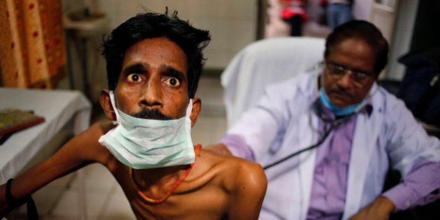 An Indian doctor examines a tuberculosis patient in a government TB hospital on World Tuberculosis Day...