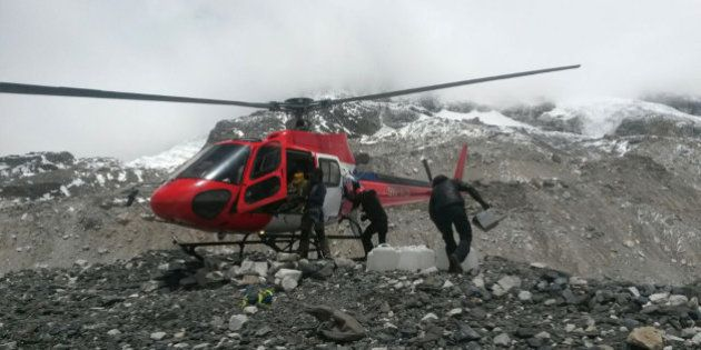 A rescue chopper lands carrying people from higher camps to Everest Base Camp, Nepal, Monday, April 27,...