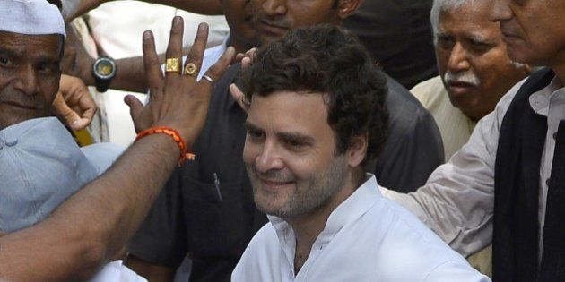 Indian Congress Party vice-president Rahul Gandhi gestures as he meets farmers during a meeting outside...