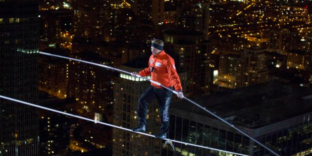 IMAGE DISTRIBUTED FOR DISCOVERY COMMUNICATIONS - Nik Wallenda walks over the Chicago River uphill nearly...