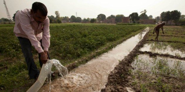 Indian farmer Jagdish Patel irrigates his field on the outskirts of Allahabad, India, Thursday, April...