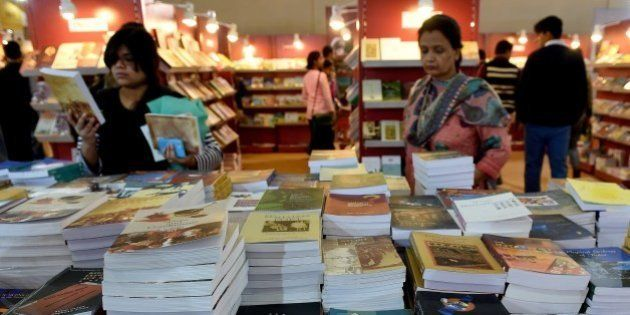 Indian visitors browse at a stall at the World Book Fair in New Delhi on February 16, 2015. TheNew...