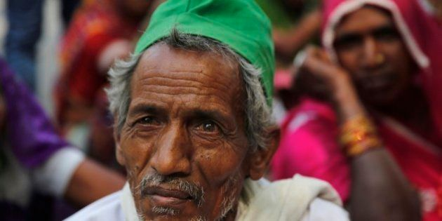 Indian farmers participate in a sit in protest against the federal government's land acquisition bill...