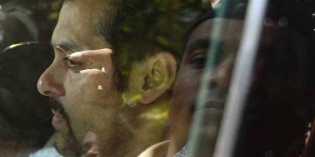 Indian Bollywood film actor Salman Khan leaves in a car after appearing at the sessions court in Mumbai...