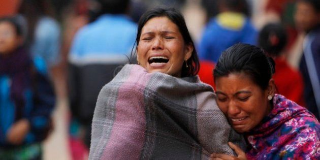 Family members break down during the cremation of an earthquake victim in Bhaktapur near Kathmandu,...