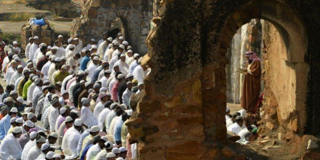 Indian Muslims offer Eid-al-Adha prayers among the ruins of the Feroz Shah Kotla mosque in New Delhi...