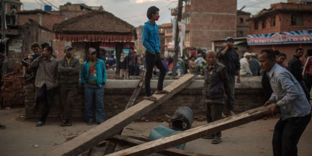 BHAKTAPUR, NEPAL - APRIL 29: Nepalese earthquake victims block a street as they protest against the lack...