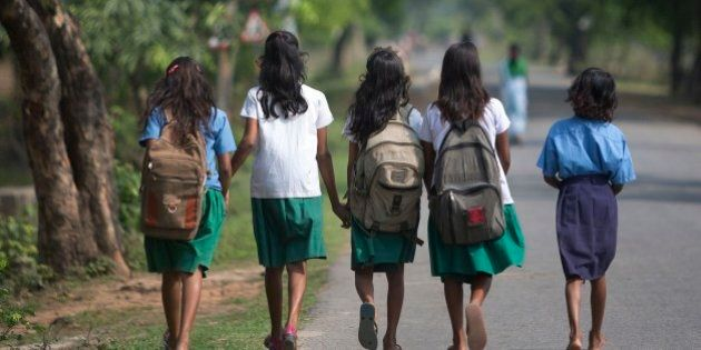 Indian girls walk to a school at Burha Mayong village about 45 kilometers (28 miles) east of Gauhati,...