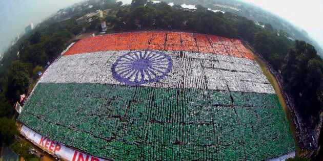 In this Sunday, Dec. 7, 2014 photo, an aerial picture shows the Indian national flag formed by volunteers...