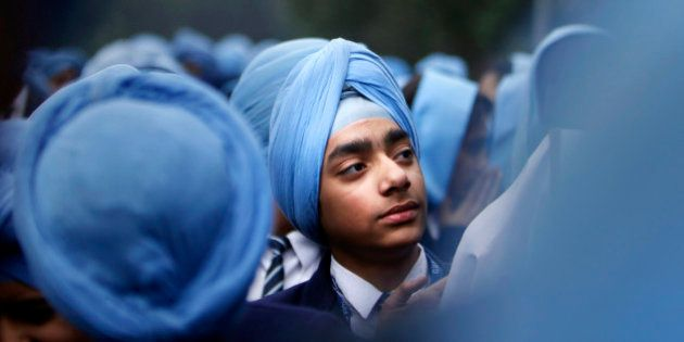 Indian Sikh school students participate in a protest against the ban on wearing turban in public schools...