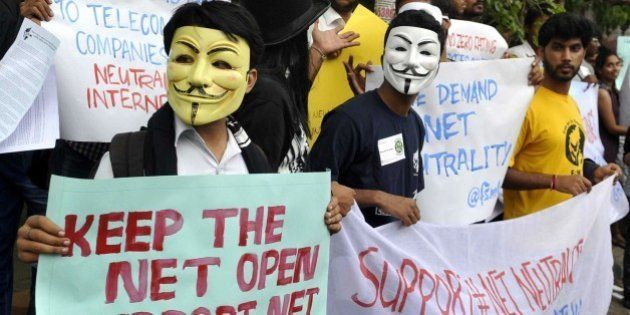 Indian activists wear Guy Fawkes masks as they hold placards during a demonstration supporting 'net neutrality'...