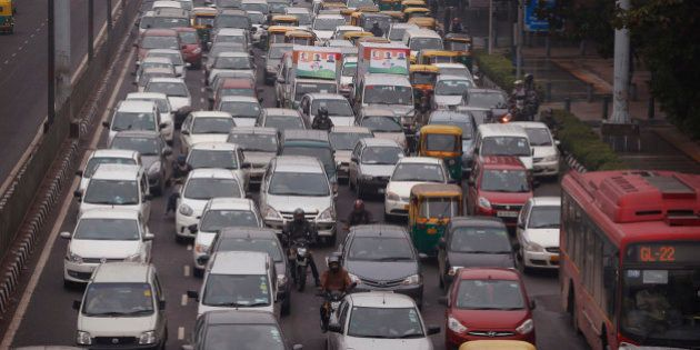 In this Thursday, Jan. 22, 2015 photo, traffic moves at dusk in New Delhi, India. When U.S. President...
