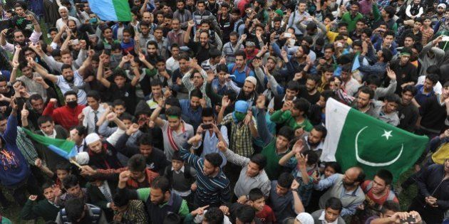 Kashmiri muslims shout anti-India and pro-freedom slogans as Kashmiri separatist leader Syed Ali Shah...