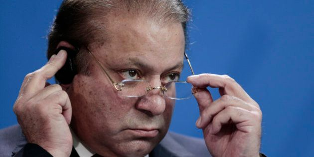 Pakistani Prime Minister Nawaz Sharif attends a news conference with German Chancellor Angela Merkel...