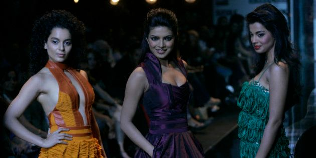 L- R, Bollywood actors Kangana Ranavat, Priyanka Chopra and Mugdha Godse display a creation by designer...