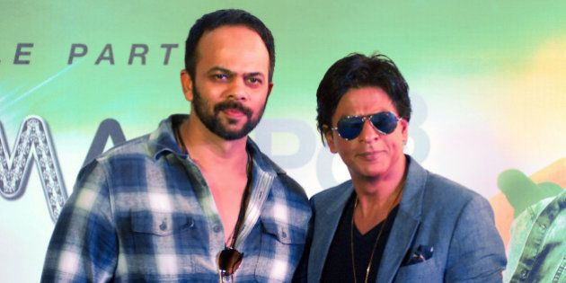 Indian Bollywood actor Shah Rukh Khan (R) poses during a promotional event for the forthcoming Hindi...