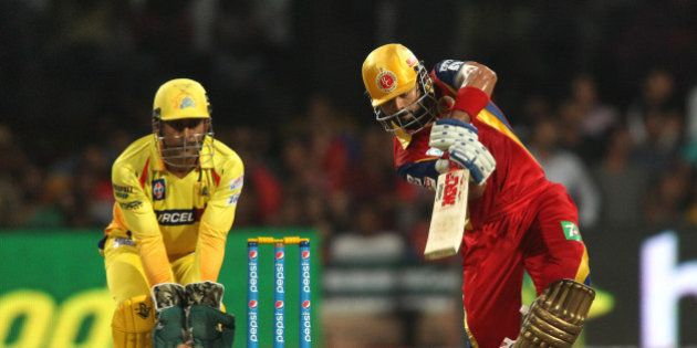 Royal Challengers Bangalore captain Virat Kohli drives a delivery during match 20 of the Pepsi IPL 2015...