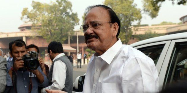 Indian Parliamentary Affairs Minister Venkaiah Naidu gestures as he arrives for the joint session of...