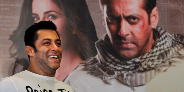 FILE - In this Sunday, Aug. 12, 2012 file photo, Bollywood actor Salman Khan smiles as he stands in front...