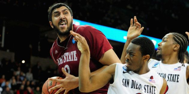 SPOKANE, WA - MARCH 20: Sim Bhullar #2 of the New Mexico State Aggies is defended by Xavier Thames #2...