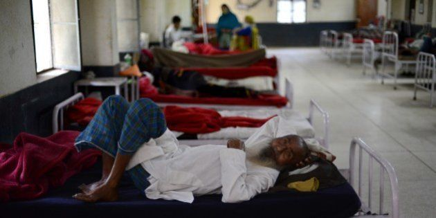 An Indian tuberculosis patient looks on as he rests at the Rajan Babu Tuberculosis Hospital in New Delhi...