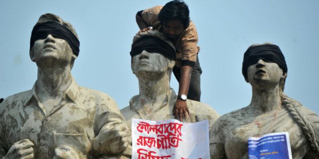 DHAKA, BANGLADESH - 2015/02/27: Students gather to voice their anger at the brutal death of the US writer...
