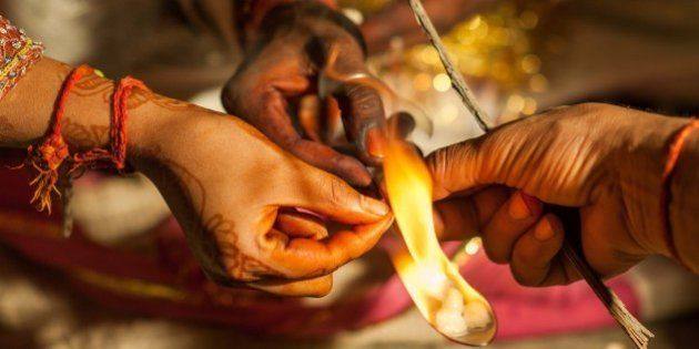 NEW DELHI, INDIA - MARH 13: The groom incenses which is believed to bring plentifulness, during his wedding...