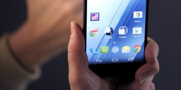 A person holds a YotaPhone 2, the new model of Russian mobile broadband services provider and smartphone...