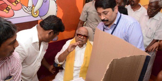Former Chief Minister of the southern Indian state of Tamil Nadu and President of the Dravida Munnetra Kazhagam (DMK) M.K. Karunanidhi (C) along with his grand-nephew and former union minister, Dayanidhi Maran (C-R) arrives to cast his vote during the national elections at a polling station in Chennai on April 24, 2014. The mammoth national election has been staggered in a bid to ensure the safety of the 814-million-strong electorate, with results due on May 16 when the opposition Bharatiya Janata Party (BJP) is forecast to take power. AFP PHOTO/STR (Photo credit should read STRDEL/AFP/Getty Images)