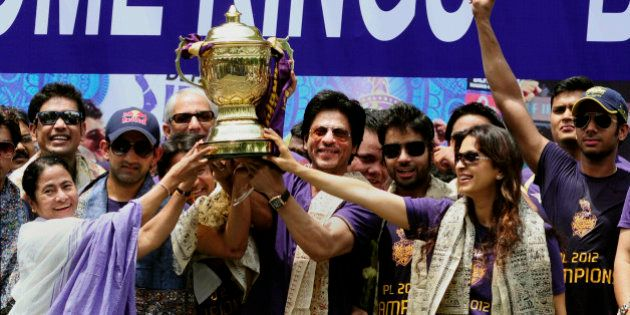 Kolkata Knight Riders team co-owners and Bollywood actors Shah Rukh Khan, center and Juhi Chawla, second...