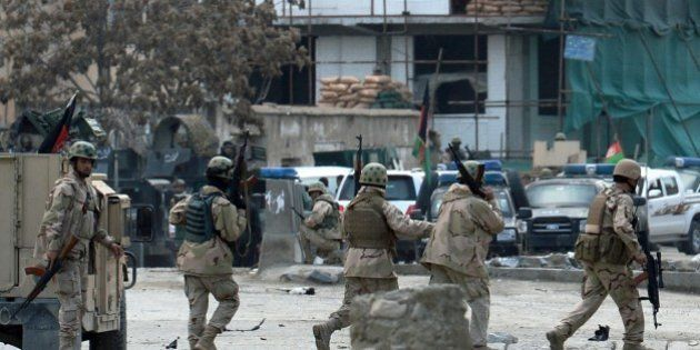 Afghan members of a special reaction team are deployed at the scene of an attack on a guesthouse by Taliban...
