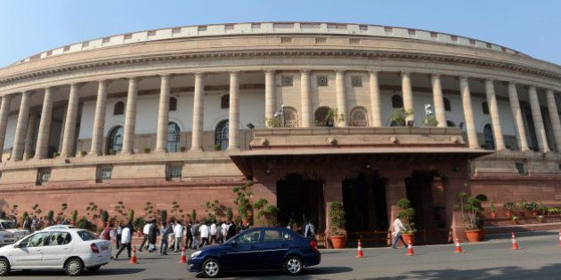 Visitors walk outside at the opening of the Winter session of Parliament in New Delhi on December 5,...