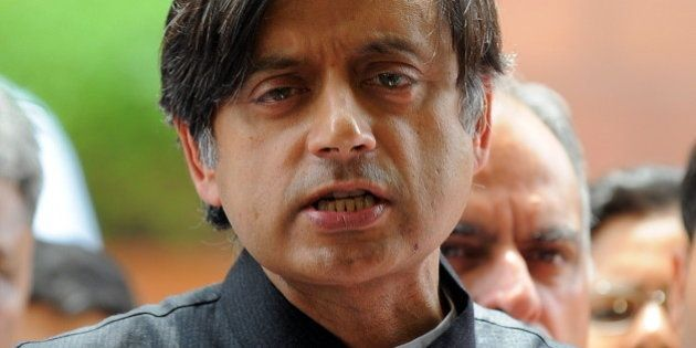 Indian Junior Foreign Minister Shashi Tharoor addresses the media at parliament house in New Delhi on...