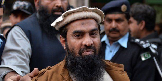 Pakistani security personnel escort Zaki-ur-Rehman Lakhvi (C), alleged mastermind of the 2008 Mumbai...