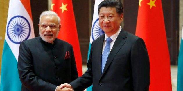 Indian Prime Minister Narendra Modi, left, and Chinese President Xi Jinping pose for a photo prior to...