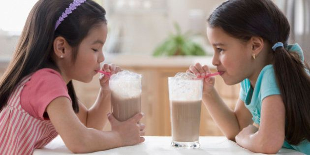 Girls drinking chocolate milk
