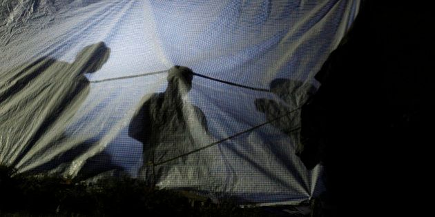 people rest inside a makeshift tent in an open space in Kathmandu, Nepal, Tuesday, May 12, 2015. A new...