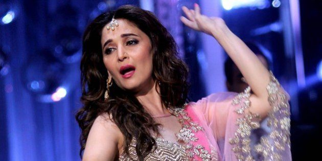 Indian Bollywood film actress Madhuri Dixit, as a judge, performs during the grand finale of the television...