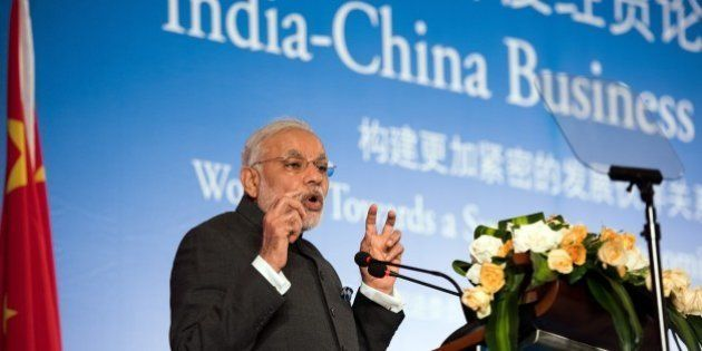 India's Prime Minister Narendra Modi delivers a speech at the India-China Business Forum in Shanghai...
