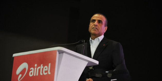 Chairman and Managing Director of the Bharti Airtel Limited, Sunil Mittal delivers his speech during...