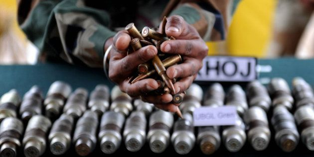 Indian army officials display arms and ammunition at Handwara in north Kashmir some 80 km from Srinagar...