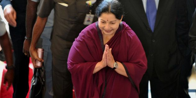 Indian chief minister of Tamil Nadu J. Jayalalithaa (C) arrives at a hotel in Bangalore to take part...