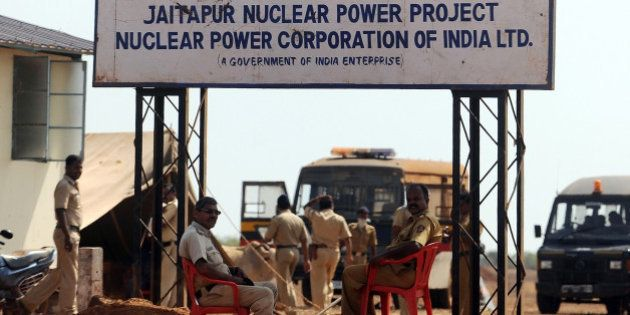 Police officers guard the proposed site of the Nuclear Power Project near Jaitapur, some 400 kilometres...