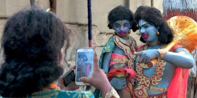 Indian artists dressed as monkey god Hanuman have a picture clicked on a mobile phone prior to Rama Navami...